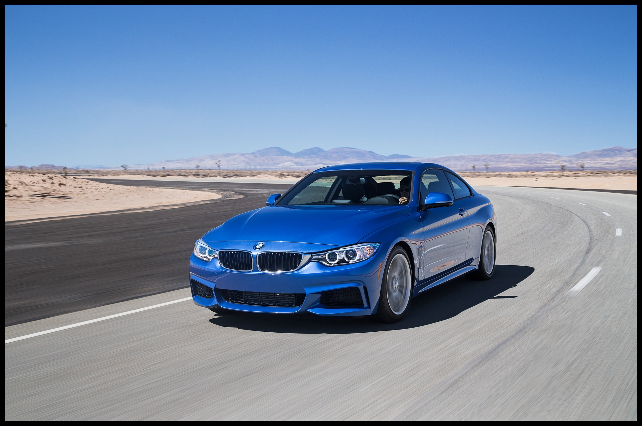 2014 BMW 428i front three quarters in motion 02 750x498