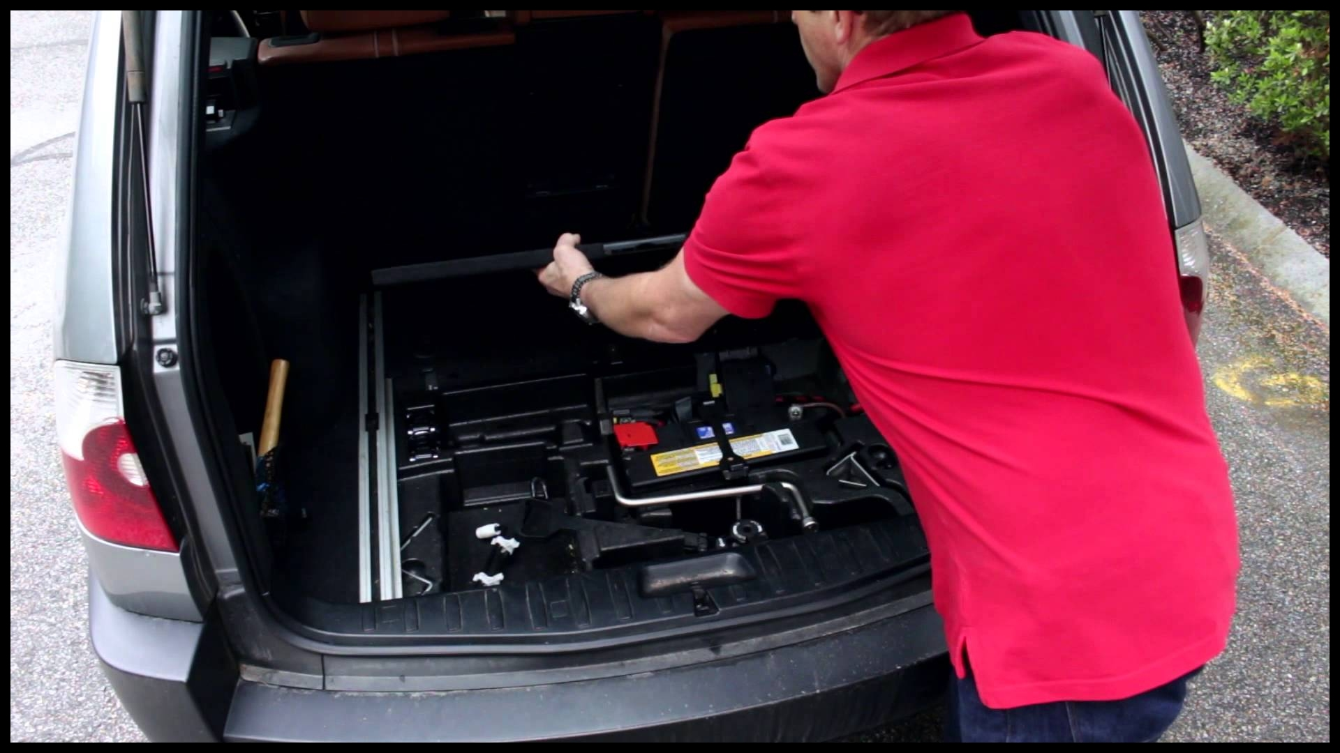 How to Access and Remove the Spare Tire in a BMW X3 E83