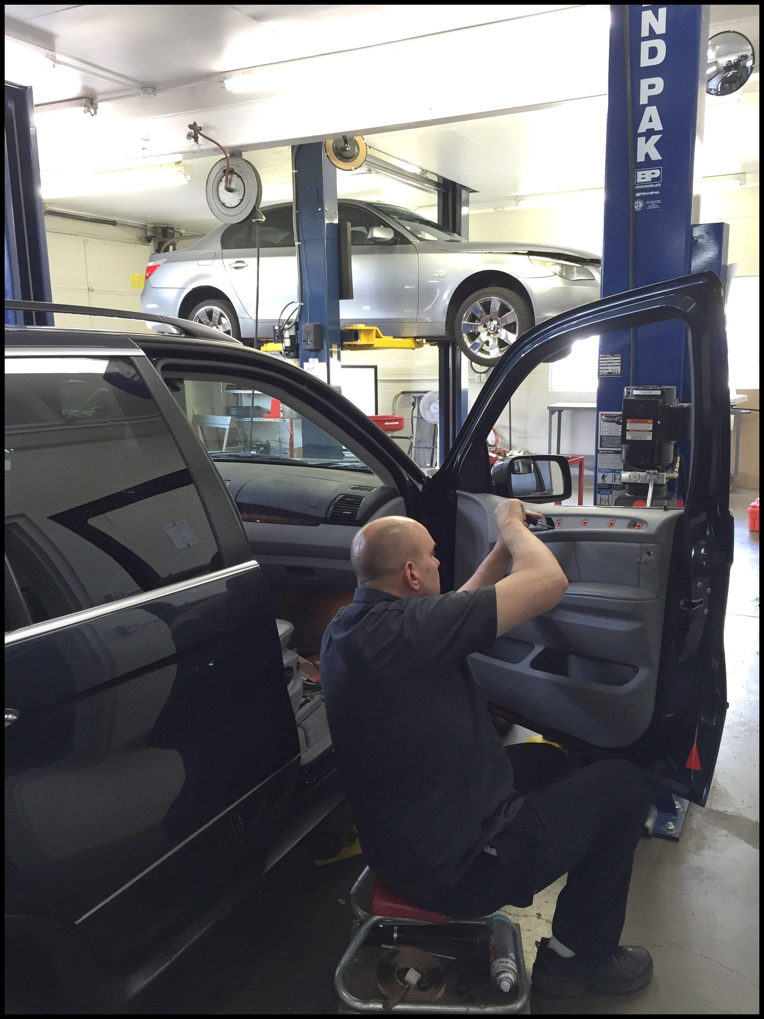 Ex dealership BMW Master technician repairing front window regulator on a BMW X5