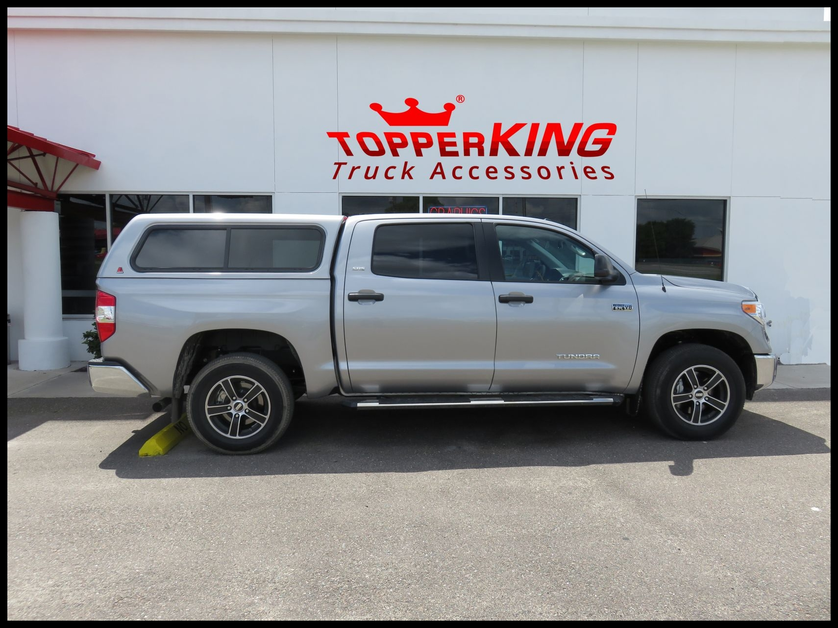 Toyota Tundra LEER 100XR fiberglass topper and a custom hitch by TopperKING in Brandon FL